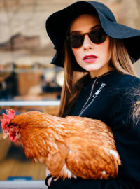 Woman and pet chicken